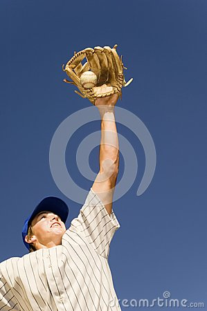 Baseball Player Trying To Catch Base Ball