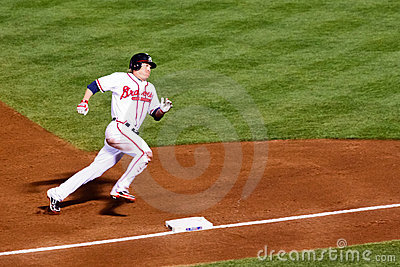 Baseball - Rounding Third, Heading for Home! Editorial Photography