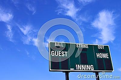 Baseball scoreboard and blue sky