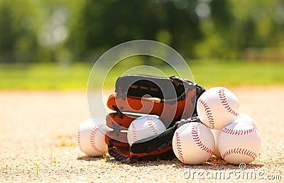 Baseballs and Glove on Field