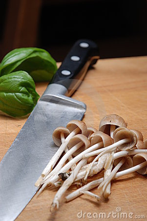 basil sprig, mushrooms knife