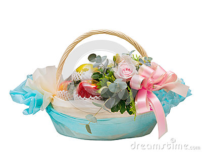 Basket of apple fruit and roses flowers for giving isolated on white