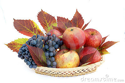 Basket with apples and grapes