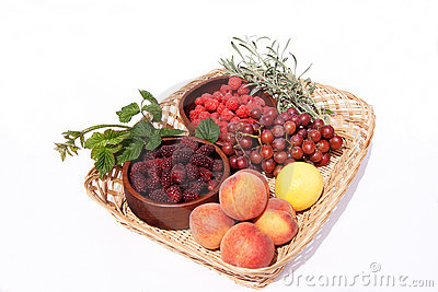 Basket with bowls of fresh fruit