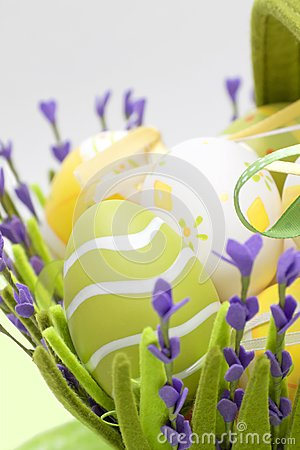 Basket with colourful eggs