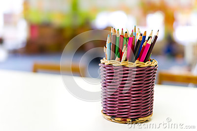 Basket of colourful kids pencils