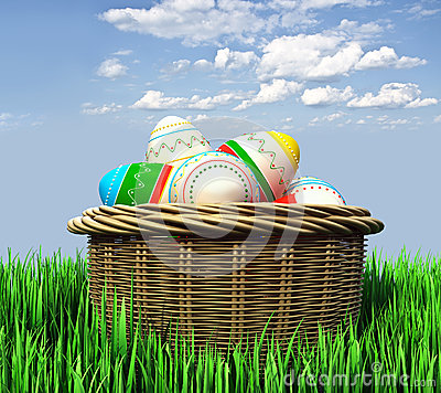 Basket with Easter eggs in the grass Stock Photo