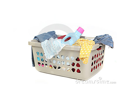 Basket Full of Dirty Laundry With Detergent