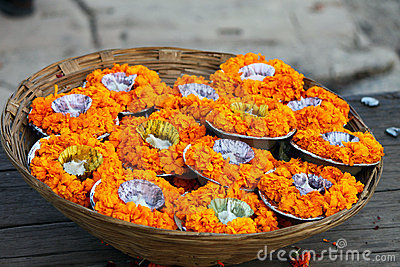 A basket full of flower pots and candles in Varanasi, India