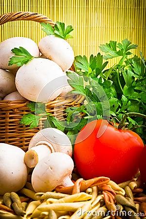 Basket full of fresh champignon mushrooms