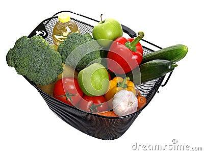 Basket full of fresh colorful vegetables.
