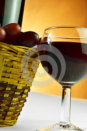 Basket of grapes and glass of wine
