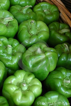 Basket of green bell peppers