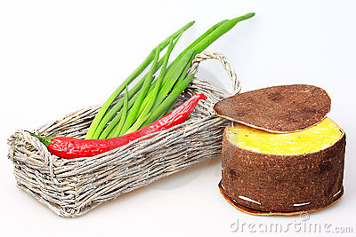 Basket with green onions and red peppers