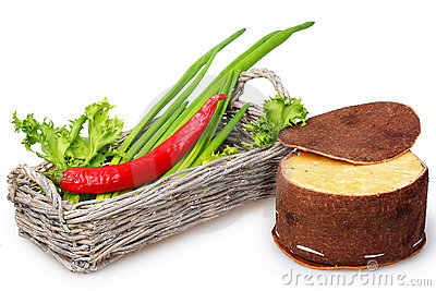 Basket with green onions and red peppers, cheese