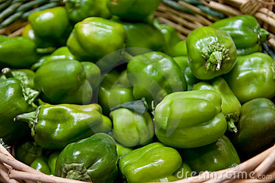 Basket of Green Peppers in a Market