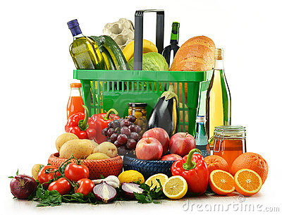 Basket with grocery products isolated on white