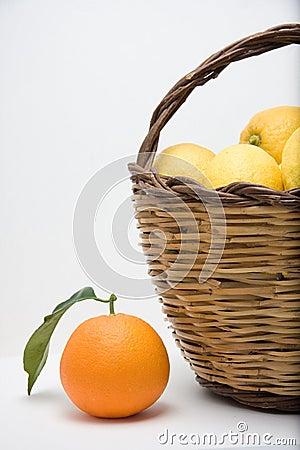 Basket of lemons and one orange