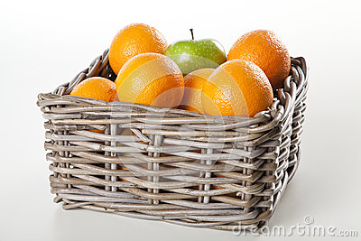 Basket of oranges and apple