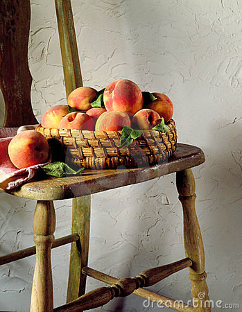 Basket of peaches on chair