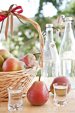 A basket with pears and pear schnapps