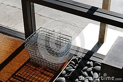 Basket by shop doorway