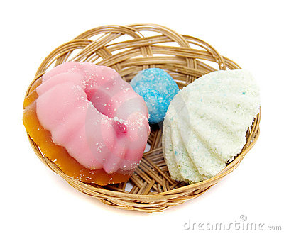 Basket with spa soaps on white