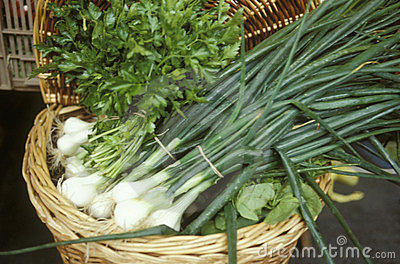 Basket of spring onions and parsley