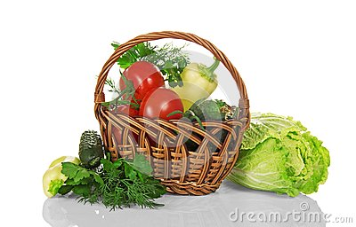 Basket with vegetables, pepper and cucumber