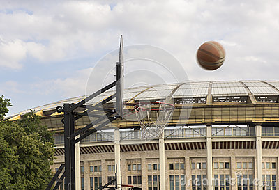 Basketball. The ball flies into the ring against the background