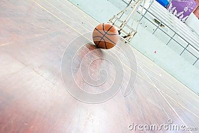Basketball ball over floor