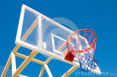 Basketball hoop on the background of sky blue. Stock Photo