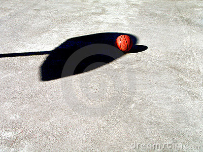 Basketball and Net Shadow Stock Photo