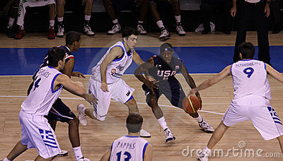 Basketball player dribbling Editorial Image
