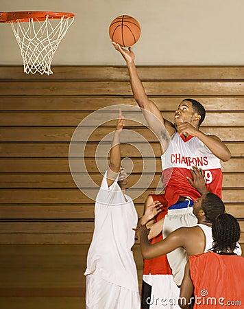 Basketball Player Dunking Basketball In Hoop