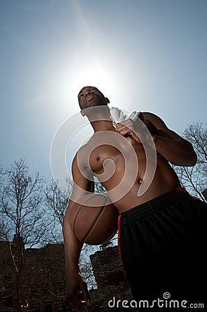 Basketball player guarding ball