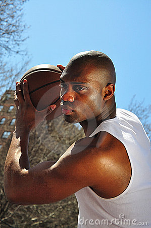 Basketball player guarding ball