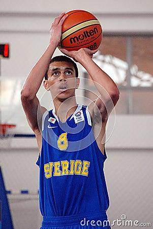 Basketball player shoots a penalty kick