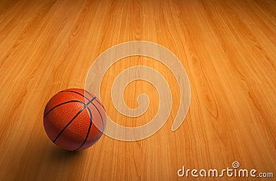 A basketball on wooden floor