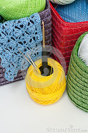 Colorful yarn for knitting in colorful baskets