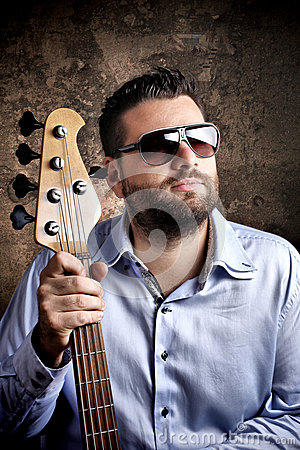 Bass player with glasses