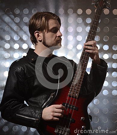 Free Bassist Playing A Custom Made  Bass Guitar Stock Image - 67679561