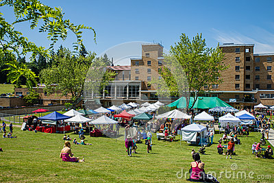 Bastyr University Herb and Food Fair vendor tents on campus lawn Editorial Stock Photo