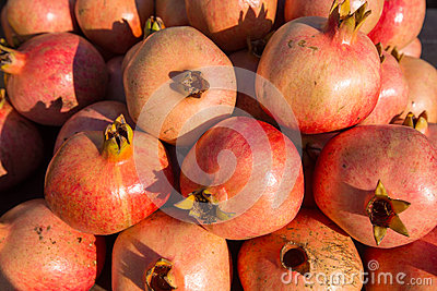 Batch of whole ripe pomegranates