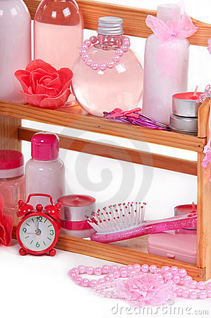 Bath accessories on a wooden shelf and alarm clock