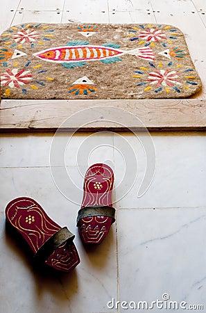 Bath clogs and felt doormat at a Turkish hamam