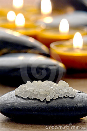 Bath Salts on Polished Stone with Candles in a Spa