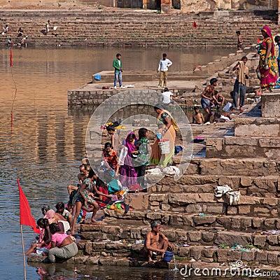 Bathing and washing at the local ghat at Khajuraho, India Editorial Photography