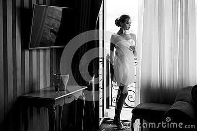 Bathrobe woman with champagne. Elegant beautiful woman. Female slim young model with make-up. Stock Photo
