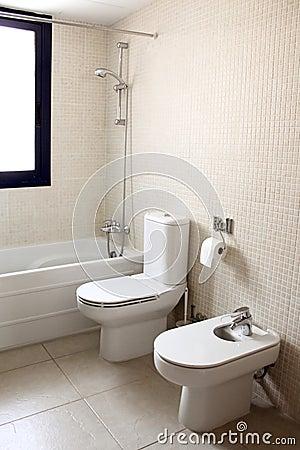 Bathroom with bath toilet and bidet